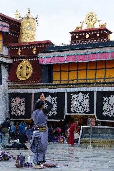 Prostating Pilgrims in front of Jokhang Temple in Lhasa, Tibet