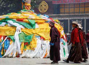 Tibetans walking on Barkhor Street around Jokhang Temple