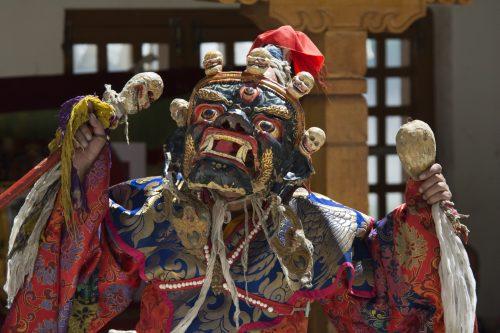 Buddhist monk performing Cham Dance during Tibetan Buddhist Festival