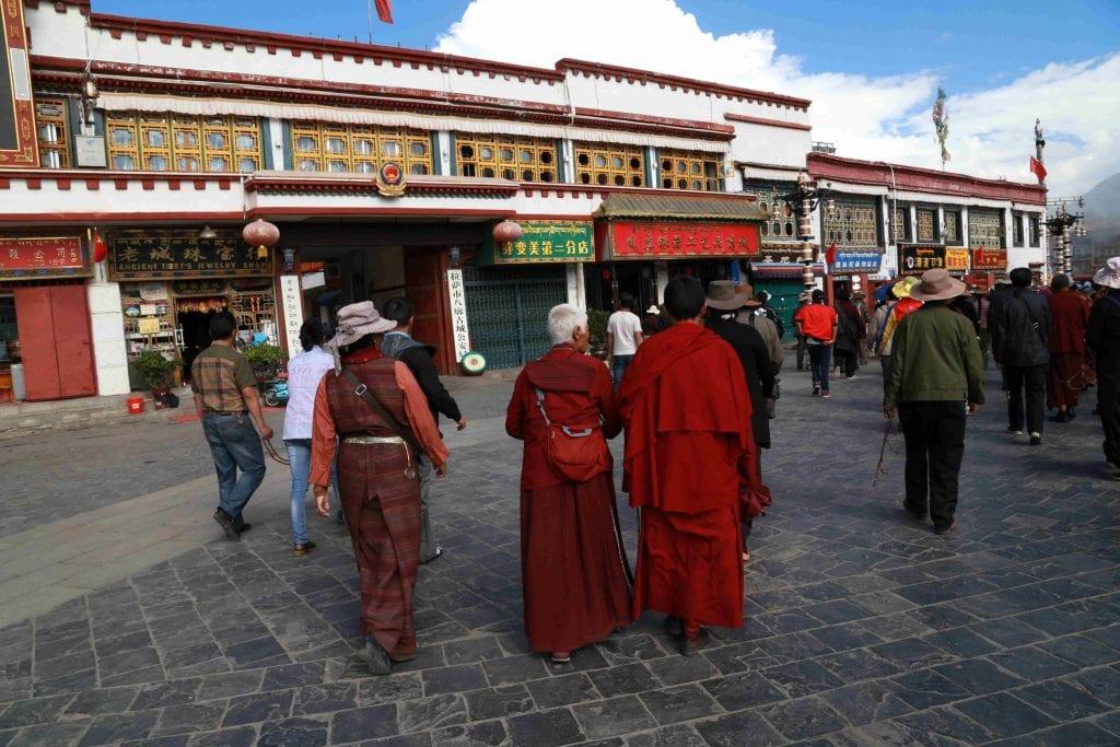 Tibetans walking on the Barkhor Street in Lhasa