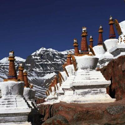 Stupas on the hillside of sacred Mount Kailash in Western Tibet