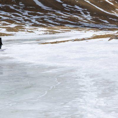 Walking on a frozen road around sacred Mountain Kailash Tibet
