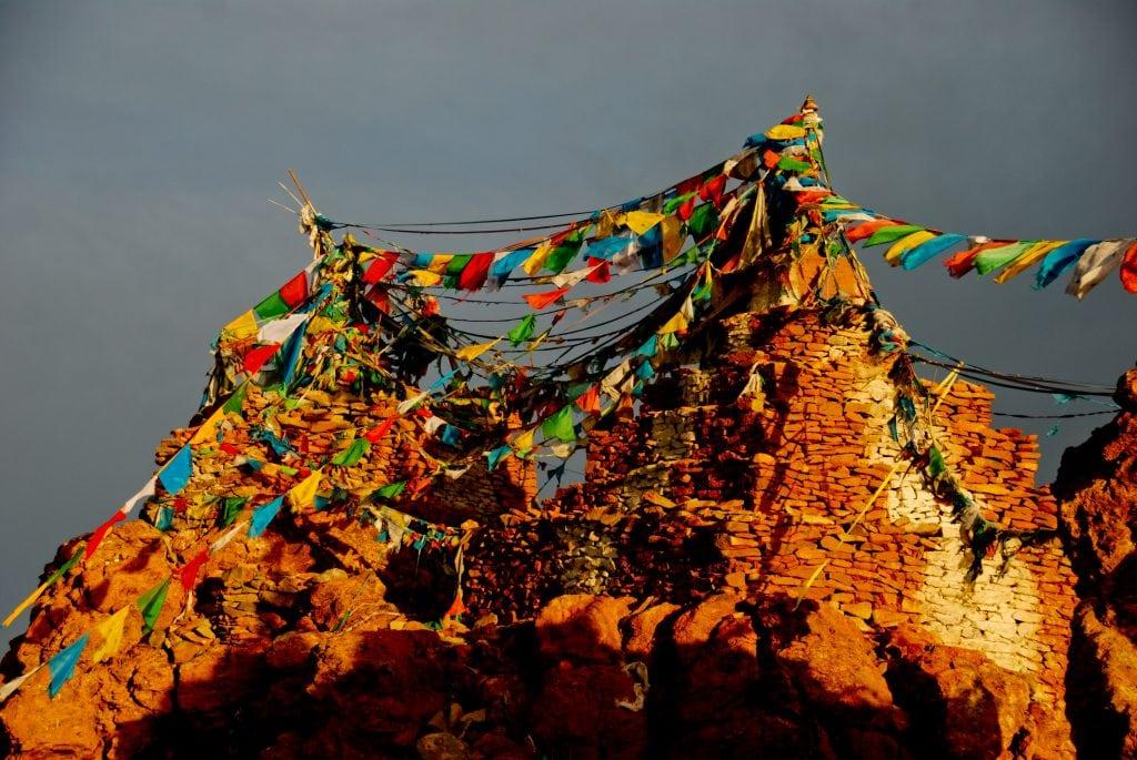 Stupas decorated with prayer flags near Manasarovar lake
