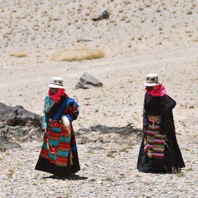 Tibetan women walking sacred kora around Namtso lake in Tibet