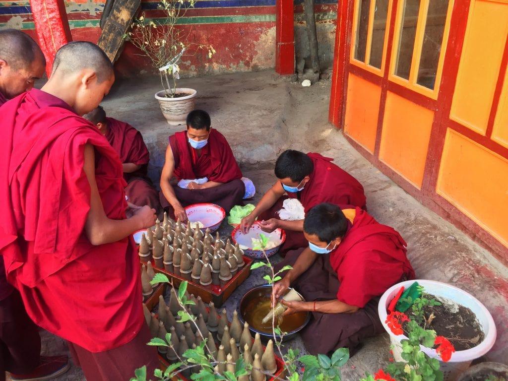 Monks making butter sculptures