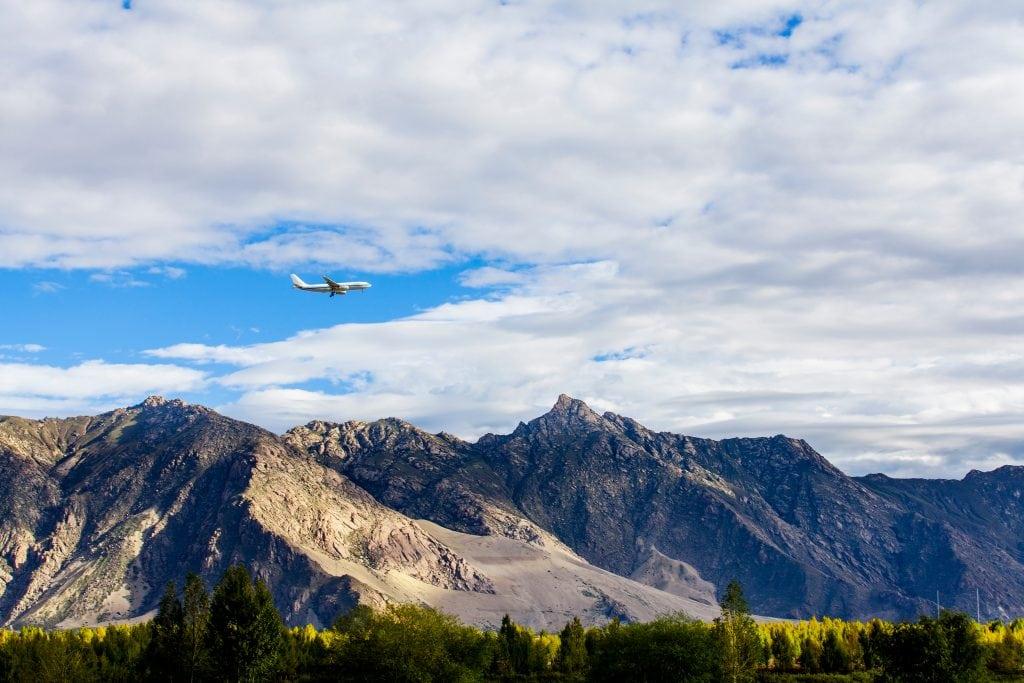 Plane flying towards Tibet above the mountain range