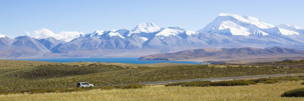 Driving by the mountain Gurla Mandhata in Burang, Tibet.