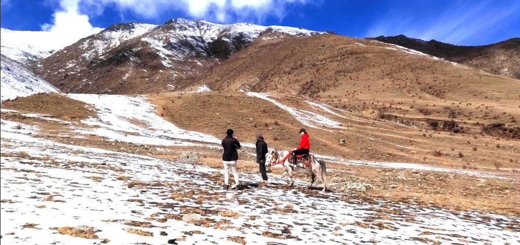 Horse riding near Ganden monastery