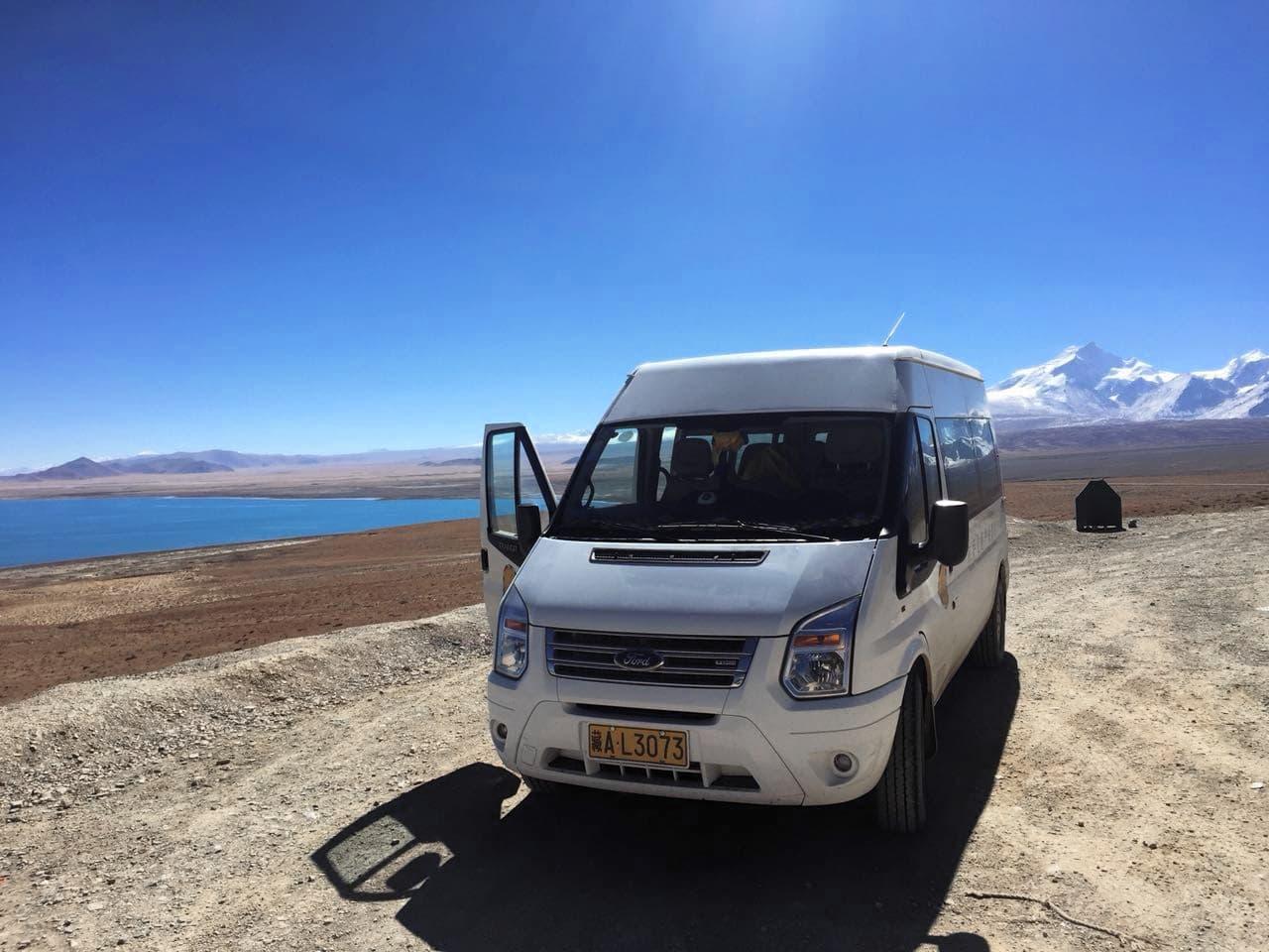 Minivan by the Yamdrok Lake in Tibet