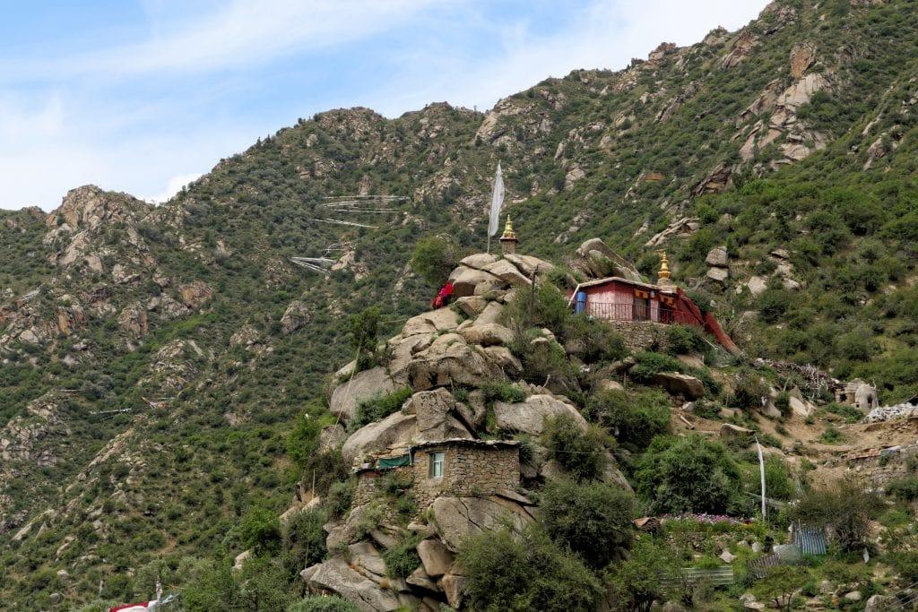 PIlgrims visiting meditation cave of Guru Rinpoche in Chimpu