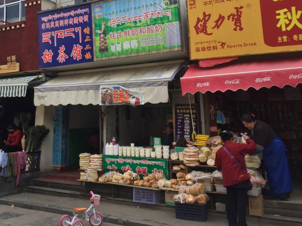 Tibetan bread and yogurt seller near Potala Palace, Lhasa