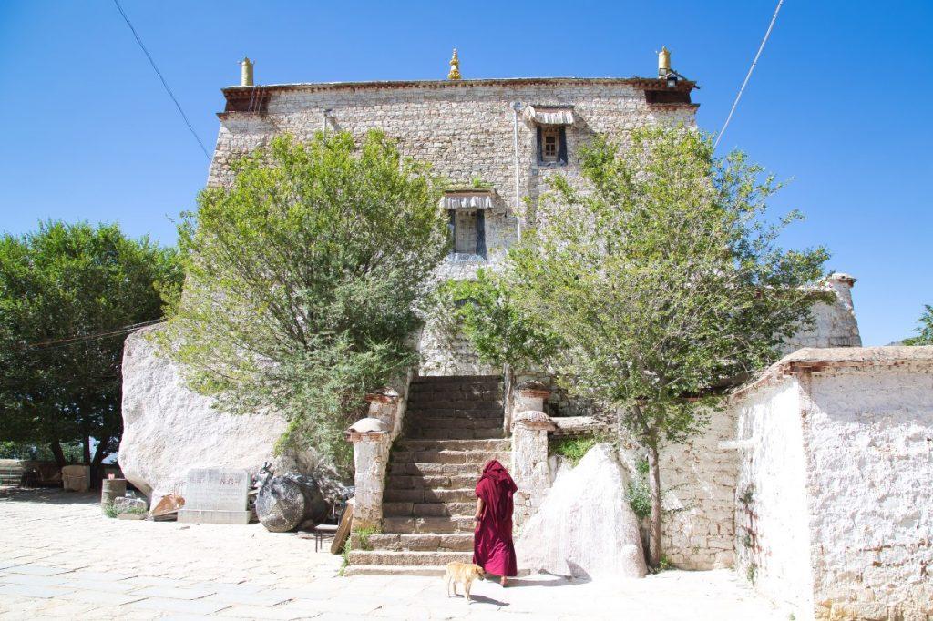 Monk walking in the chapel in Pabongka