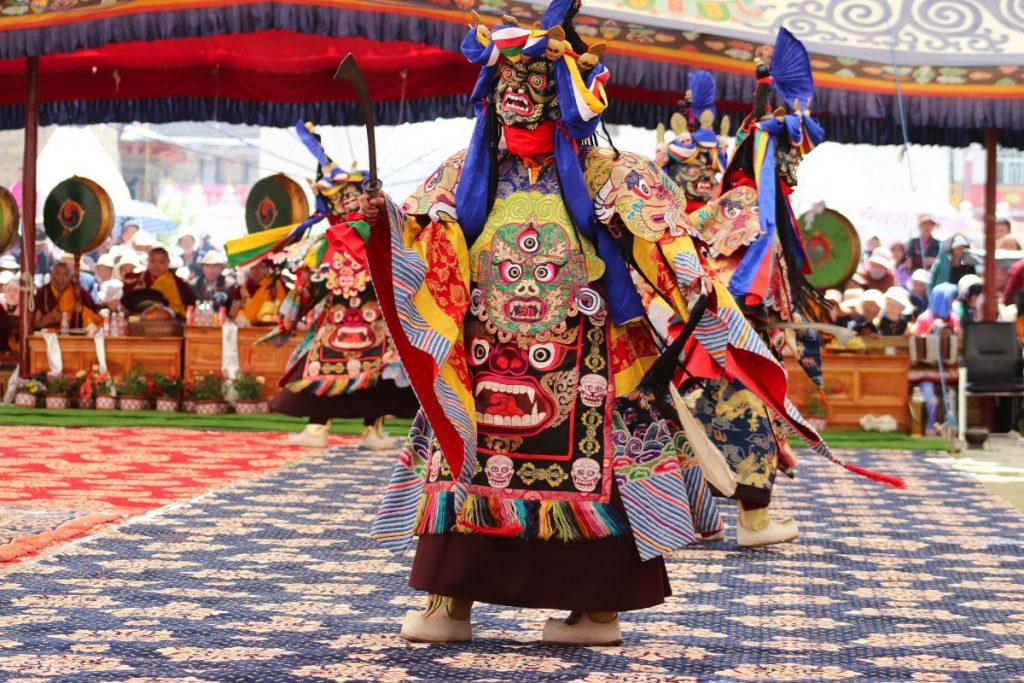 Several Tibetan monks performing Cham Dance