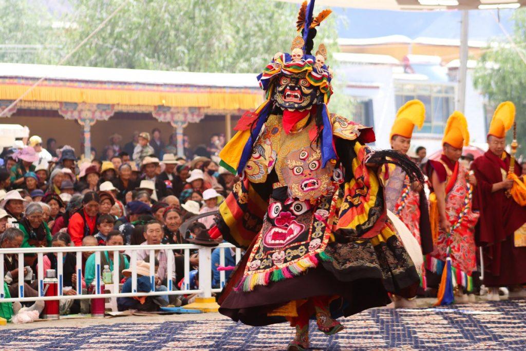 Tibetans watching the Cham Dance